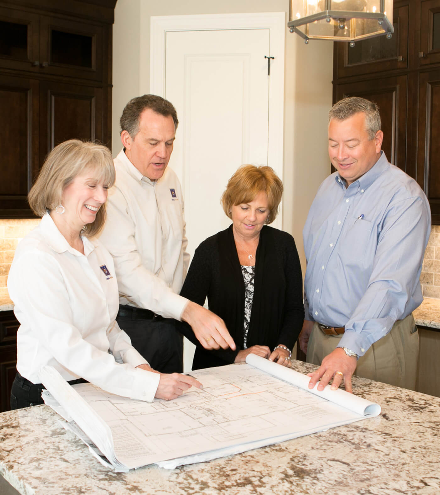 Hibbs Homes, Salt Lake City custom home builders, holding a design meeting