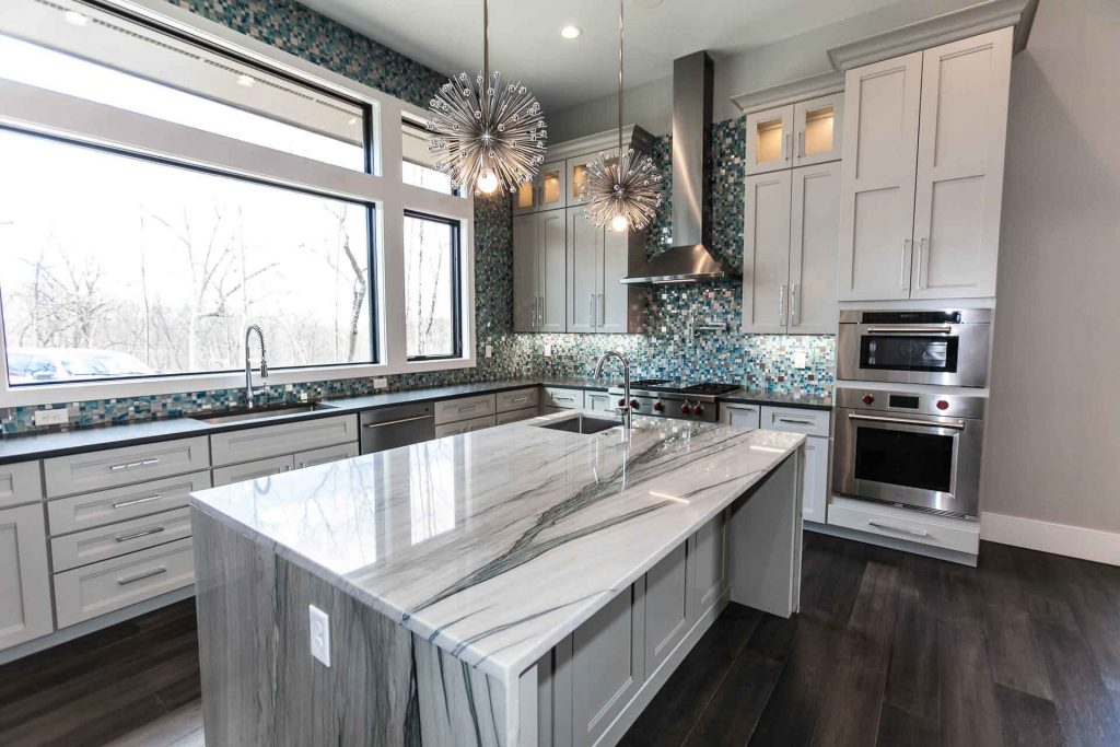 Marble island in a kitchen of a custom home by Hibbs Homes